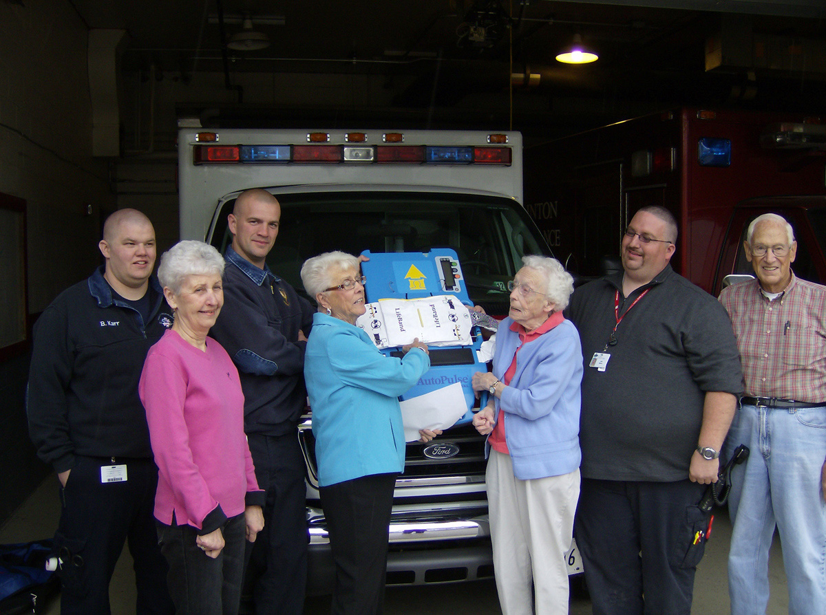 foundation members with Autopulse for the Ambulance Department