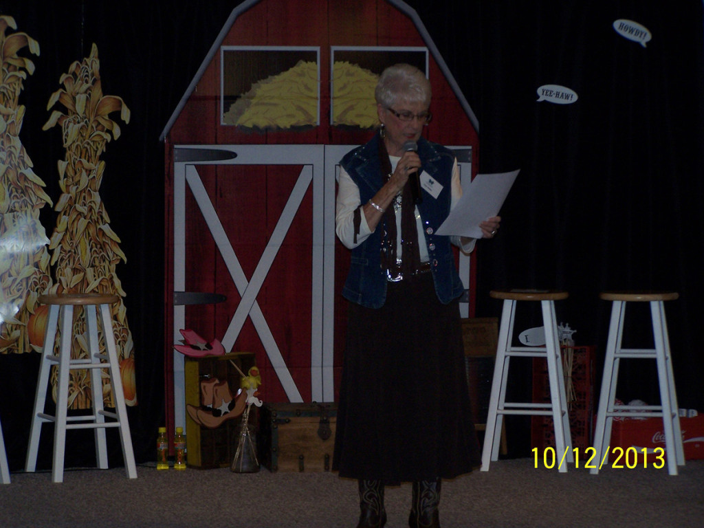 woman speaking at harvest gala
